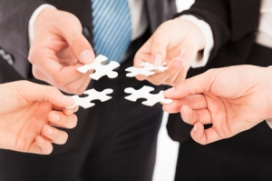 Business people Holding Jigsaw Puzzle