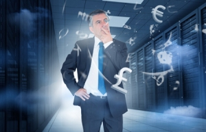 Businessman standing and thinking in data center with currency graphics
